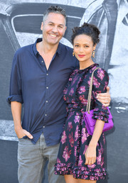 Thandie Newton attended the UK premiere of 'Yardie' carrying a purple croc-embossed clutch with a gold chain strap.