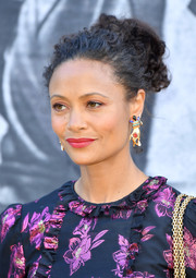Thandie Newton went for vibrant styling with a pair of dangling multi-gem earrings.