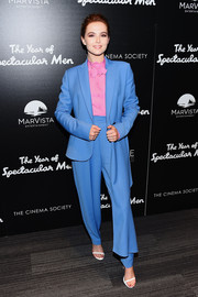 Zoey Deutch went for a cool color pairing with this blue suit and pink blouse combo by Delpozo at the premiere of 'The Year of Spectacular Men.'
