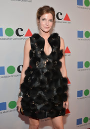 Stephanie Seymour chose an avant-garde laser-cut black dress studded all over with fur pompoms for the 2013 MOCA Gala.