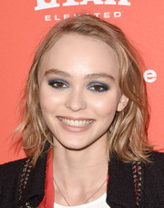 Lily-Rose Depp achieved super-sexy eyes with a smoky application of metallic-blue shadow.
