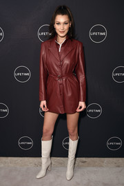 Bella Hadid teamed her jacket with white go-go boots by Gianvito Rossi.