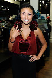 Jeannie Mai swept on vibrant violets and pink shadows for the Yoplait Light Fall Swap Event.