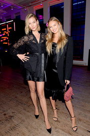 Romee Strijd layered a black blazer over a ruffle-hem LBD for the YouTube.com/Fashion launch.