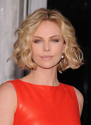 Charlize Theron wore her jaw-length bob full of volume and sexy curls at the world premiere of 'Young Adult.'