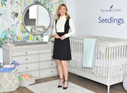 Ellen Pompeo paired black ankle-strap pumps with a preppy mini dress for the launch of baby care line, Seedlings.