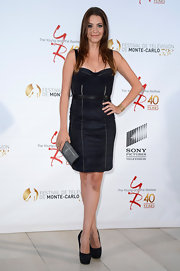 Julie Gonzalo stuck to a simple and chic look with this black bodice dress.