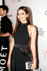 Victoria Justice accessorized with a striped box clutch by Edie Parker at the Marie Claire Young Women's Honors.