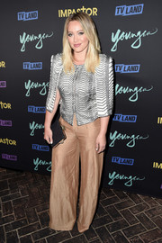Hilary Duff teamed a bold-shouldered jacket with gold wide-leg pants for the premiere of 'Younger' season 3.