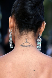 With her hair styled in an updo, Chanel Iman showed off her eponymous tattoo during the Cannes premiere of 'Youth.'