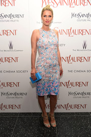 Nicky Hilton topped off her colorful outfit with a turquoise Snob Essentials box clutch.