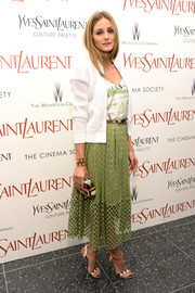 Olivia Palermo completed her stylish ensemble with a printed oval clutch.