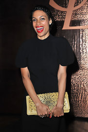Rosario Dawson broke up her all black look with a studded yellow clutch.