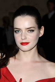 Roxane Mesquida wore a bright cherry red lipstick to the Yves Saint Laurent fashion show in Paris. To get her look, try Lorac Breakthrough Performance Lipstick SPF 15 in a shade like Leading Lady.
