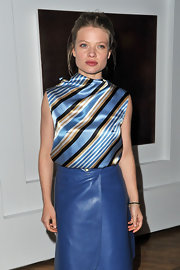 Melanie Thierry complemented her blue leather skirt with a feminine striped silk shell.