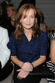 Isabelle Huppert looked demure at the YSL fashion show in a navy button-down shirt with ruched sleeves.