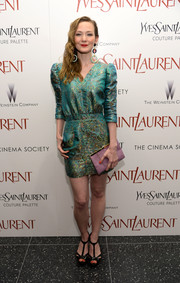 Louisa Krause teamed her dress with a pair of Art Deco-chic T-strap platform sandals.