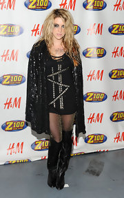Kesha wears a sequined cape with this jazzy look.