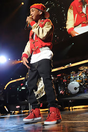 Jaden Smith heated up the 2010 Jingle Ball with his red sneakers, jacket, and baseball cap combo.