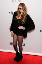 Erica America topped off her ensemble with a fun and flirty fur jacket when she attended Jingle Ball.