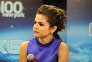 Selena Gomez swept her hair back into messy-edgy knots for Jingle Ball 2013.