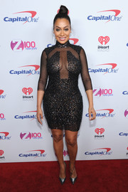 La La Anthony sent temperatures through the roof with this figure-skimming beaded peekaboo dress by Thai Nguyen Atelier during Z100's Jingle Ball 2016.