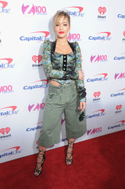 Rita Ora sealed off her look with chic black lace-up heels by Giuseppe Zanotti.