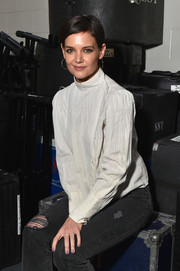 Katie Holmes added a subtle pop of color to her monochrome look with a swipe of lilac nail polish.