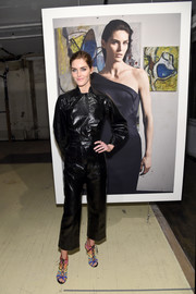 Hilary Rhoda attended the Zac Posen presentation rocking a black leather jumpsuit.