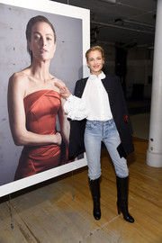 Carolyn Murphy attended the Zac Posen presentation wearing a white blouse with voluminous ruffle sleeves.