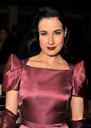 Dita Von Teese wore a muted merlot shade of lipstick instead of her signature vibrant ruby hue at the Zac Posen fall 2012 fashion show.