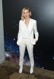 Naomi Watts went masculine-chic in a white pantsuit for the Zadig & Voltaire fashion show.