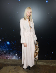 Soo Joo Park flashed just a bit of cleavage in a long-sleeve pink maxi dress with an open front during the Zadig & Voltaire fashion show.