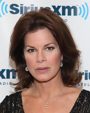 Actress Marcia Gay Harden styled her look at a SiriusXM Studio visit with a silver chain necklace with a triple diamond pendant.