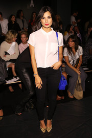 Diane Guerrero opted for a simple short-sleeve button-down when she attended the Zang Toi fashion show.