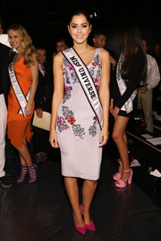 Paulina Vega showed off her figure in a fitted, flower-appliqued cocktail dress at the Zang Toi fashion show.