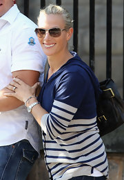 Zara Phillips attended a wedding rehearsal wearing a trendy pair of butterfly sunnies.