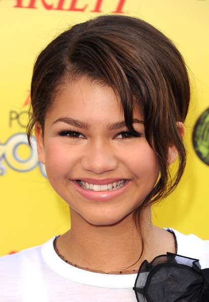 Zendaya Coleman Loose Bun [hair,face,hairstyle,eyebrow,chin,forehead,smile,nose,yellow,cheek,zendaya coleman,arrivals,the hub,california,hollywood,variety,5th annual power of youth event,power of youth,paramount studios,event]