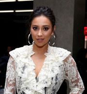 Shay Mitchell topped off her look with a messy-sexy updo when she attended the Zimmermann fashion show.