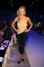Jessica Hart flaunted her slim legs in tight-fitting, ripped black jeans.