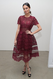 Nicole Trunfio charmed in a burgundy lace fit-and-flare dress at the Zimmermann fashion show.