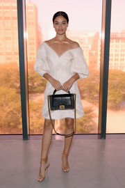 Shanina Shaik looked downright darling in a white lace-panel off-the-shoulder dress by Zimmermann during the label's Spring 2018 show.
