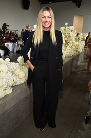 Jessica Hart kept it low-key in a black pantsuit at the Zimmermann Spring 2019 show.