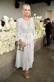 Molly Sims looked demure in a white lace midi dress at the Zimmermann Spring 2019 show.