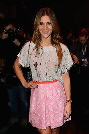 A splatter-print loose blouse gave some edge to Amanda Byram's look at the Zoe Jordan runway show.