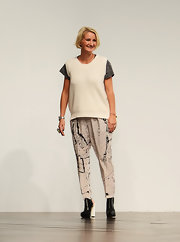 Zoe Jordan paired a basic white vest with a gray blouse and white splatter pants at her runway show in London.