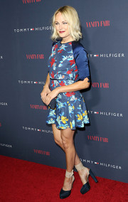 Malin Akerman teamed her flirty dress with a super-high pair of Bionda Castana ankle-wrap platform pumps.
