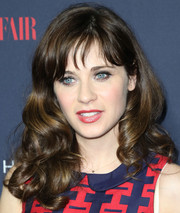 Zooey Deschanel looked darling with her bouncy curls and wispy bangs during the debut of her Tommy Hilfiger collection.