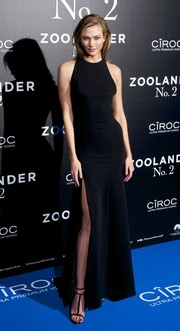 Karlie Kloss sheathed her statuesque frame in a black Carolina Herrera halter gown with a thigh-high slit for the 'Zoolander No. 2' Madrid fan screening.