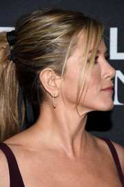 Jennifer Aniston sported a pair of diamond hoops by Sidney Garber at the world premiere of 'Zoolander 2.'